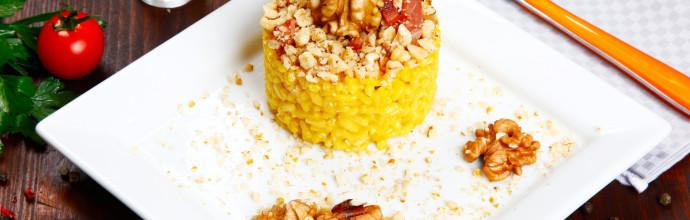 risotto with walnuts, saffron, speck on a dish